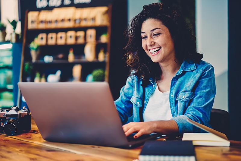 Stock-Image-Woman-Laughing-at-Computer