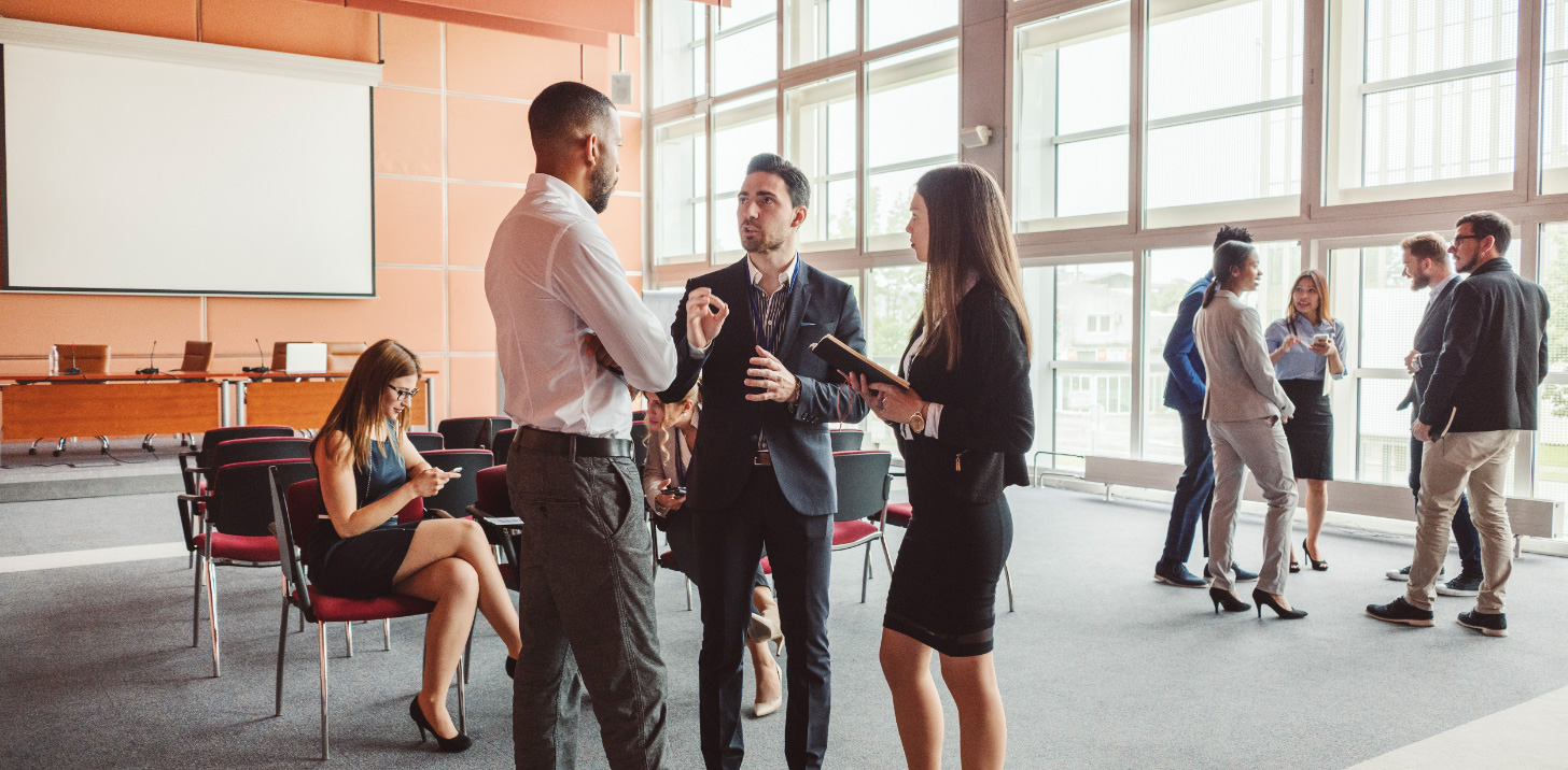 Young professionals talking to each other   AVIXA