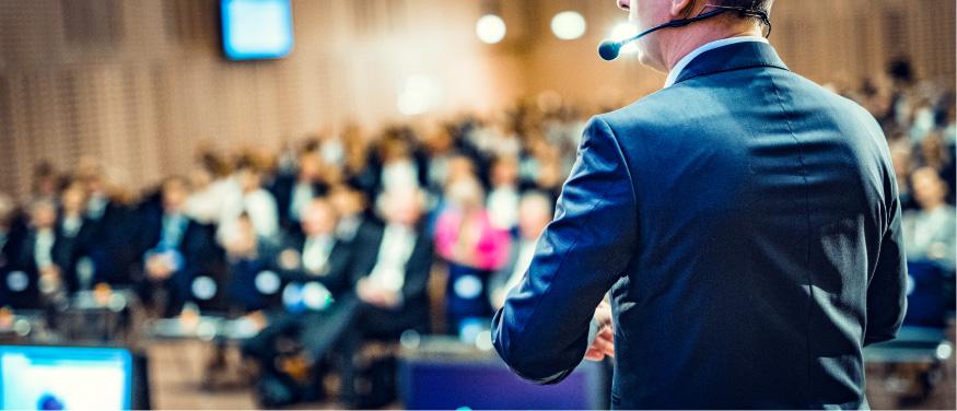Educators presenting at a conference | AVIXA