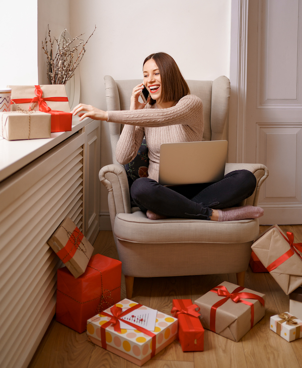 Woman sitting with presents | AVIXA