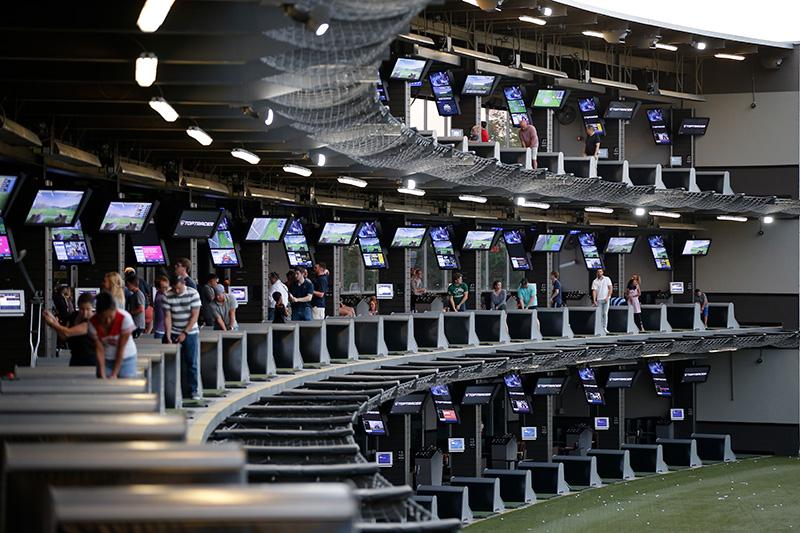 A view of Topgolf's array of entertainment bays | AVIXA